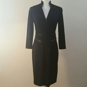 Medium length black fitted dress